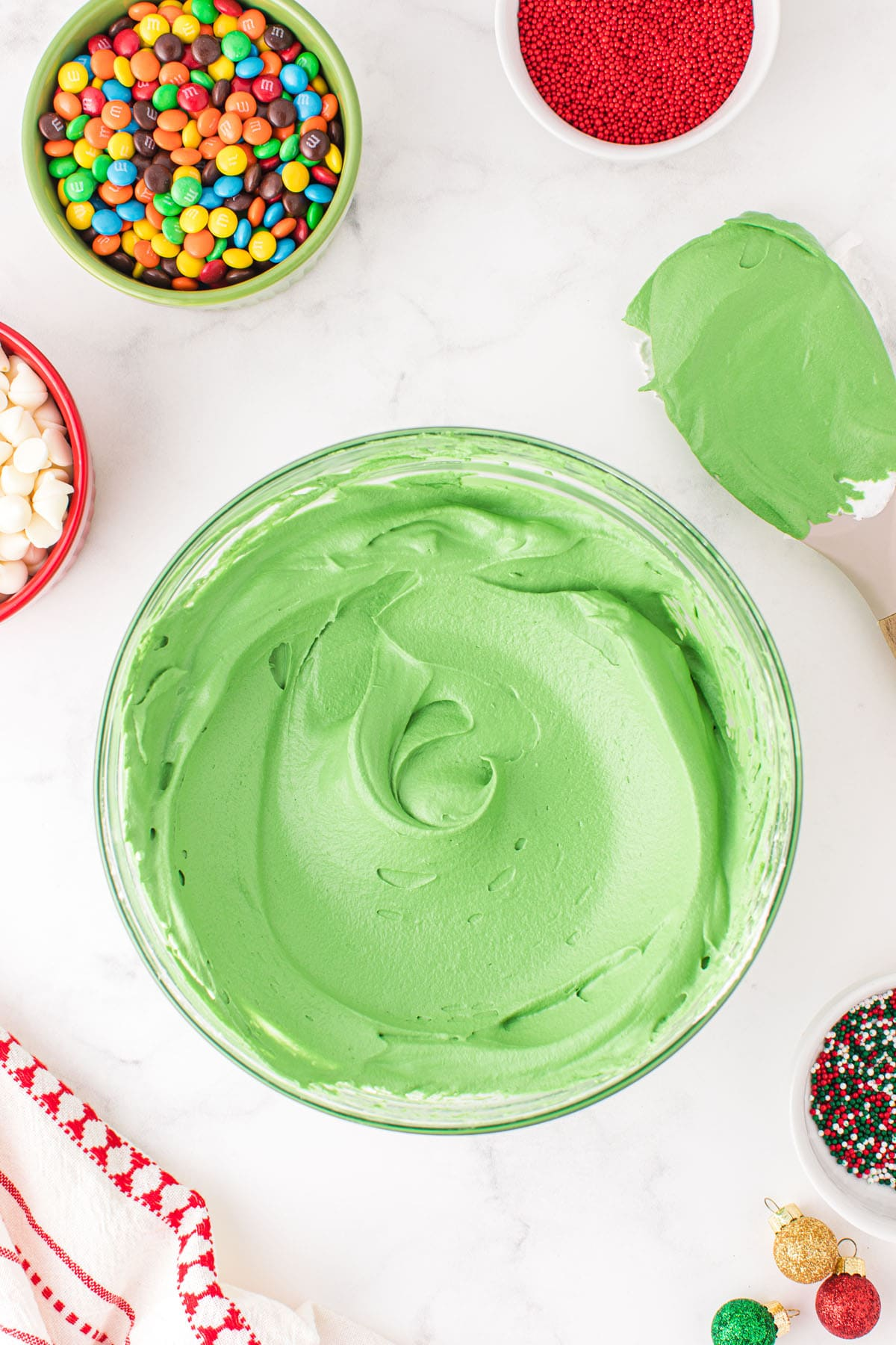 combine green food coloring with the whipped topping