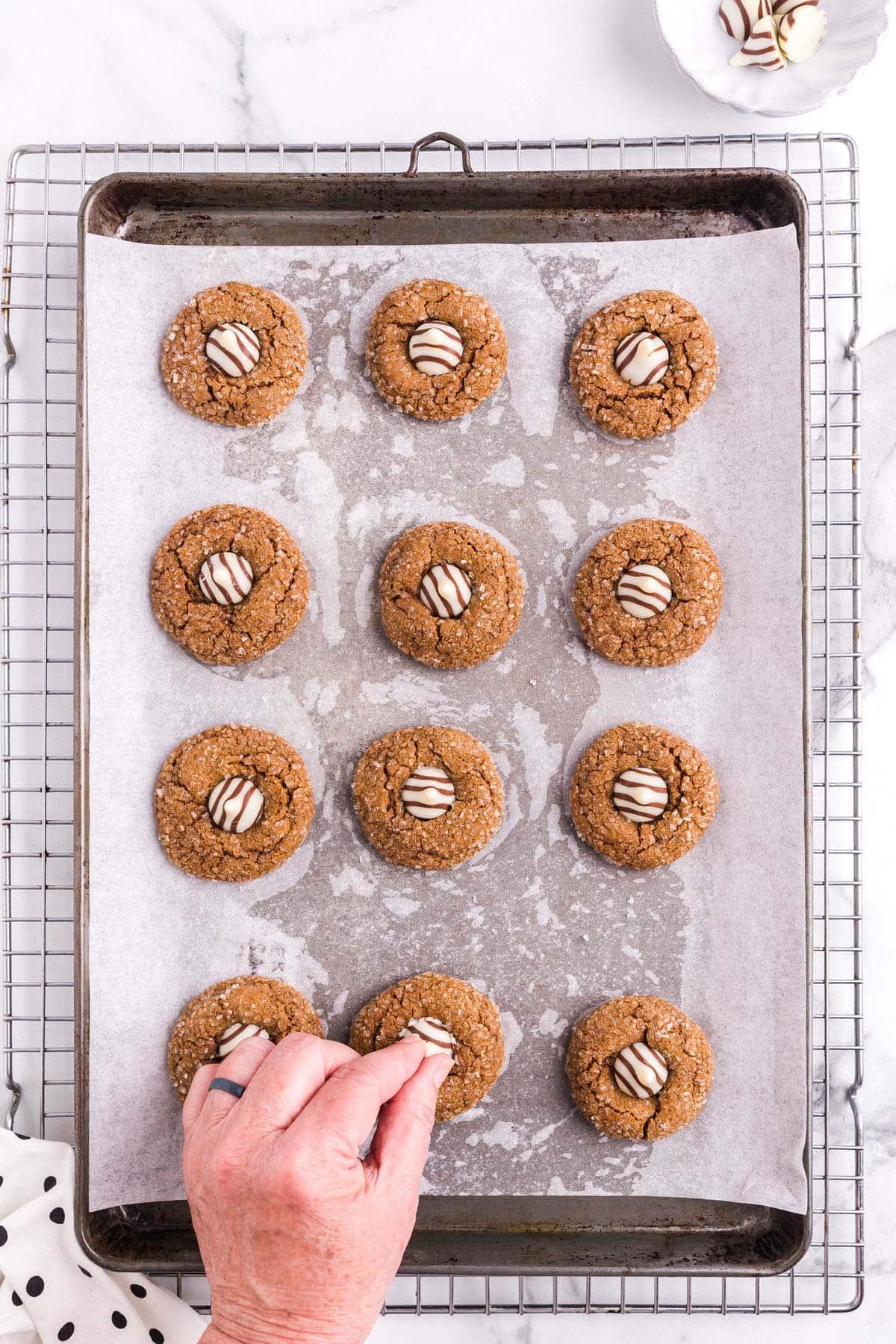 press hershey kiss on each cookie