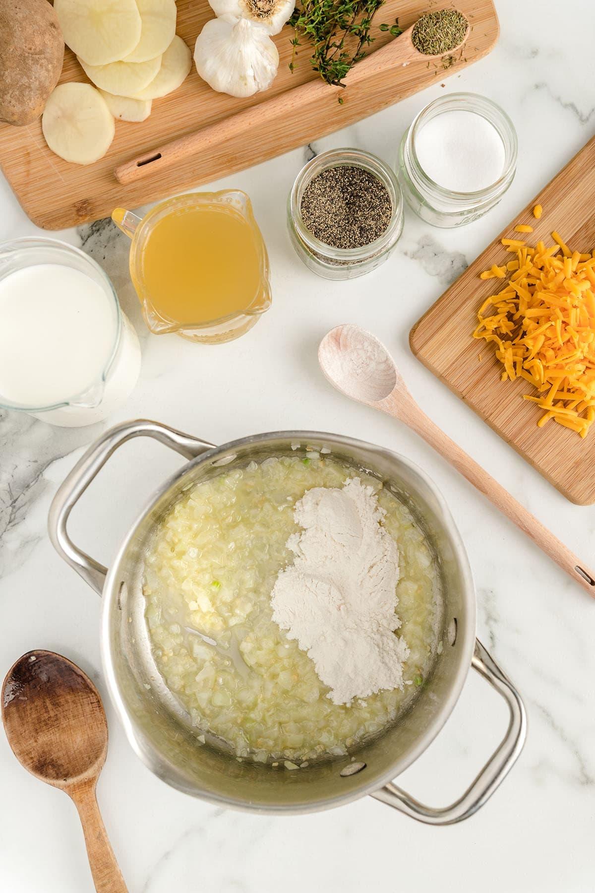 melt butter, add onion, garlic and flour