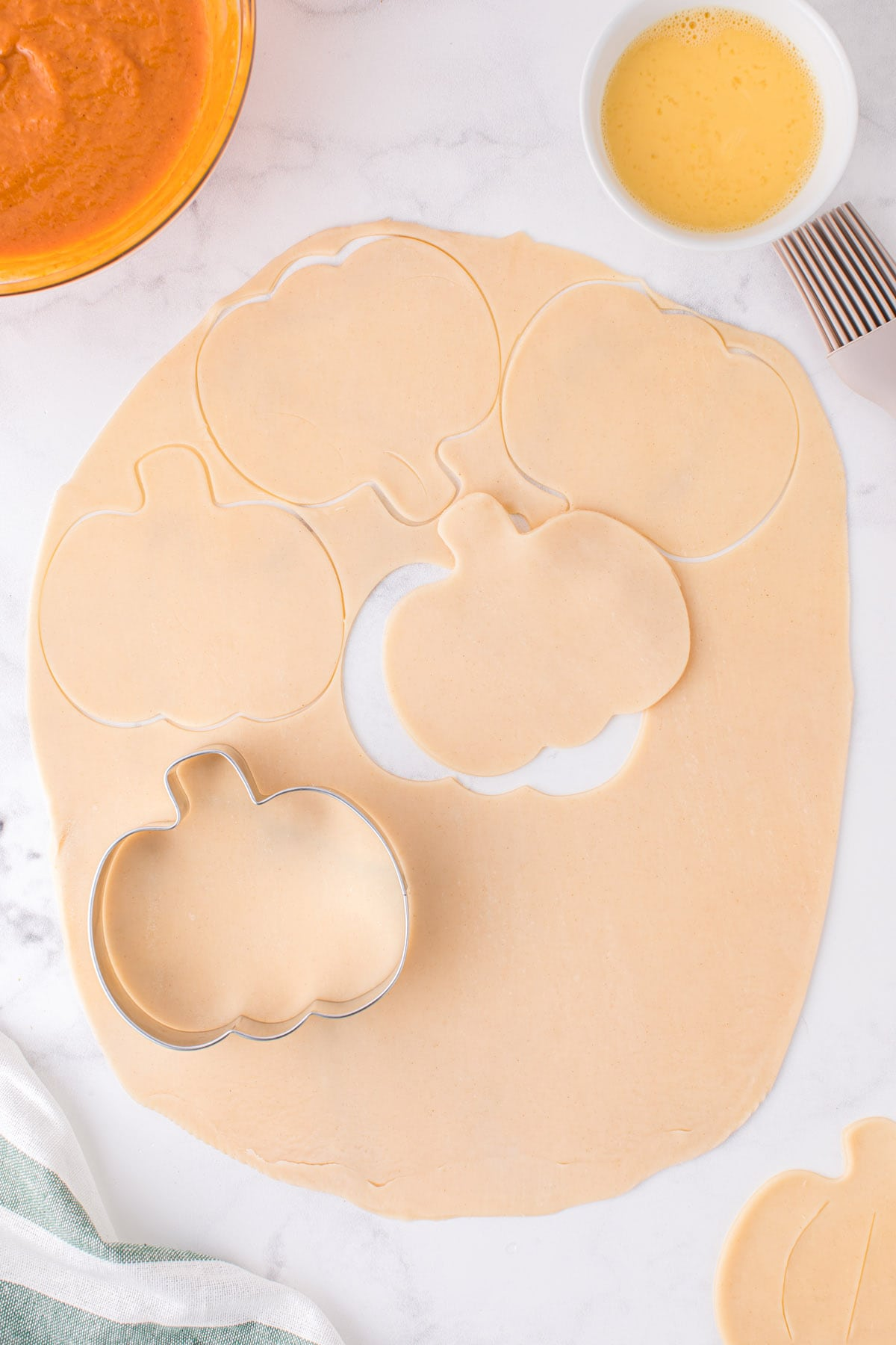 cut out pumpkin shapes with a cookie cutter