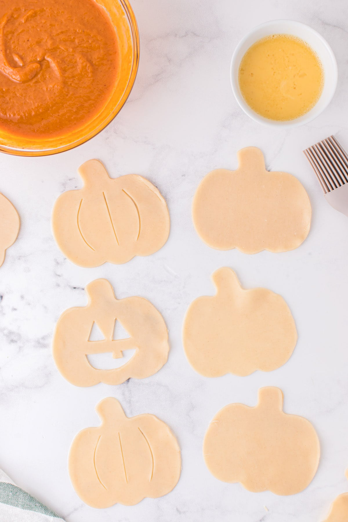 cut out faces to create Jack-O-Lanterns or draw three lines resemble the lines of a pumpkin