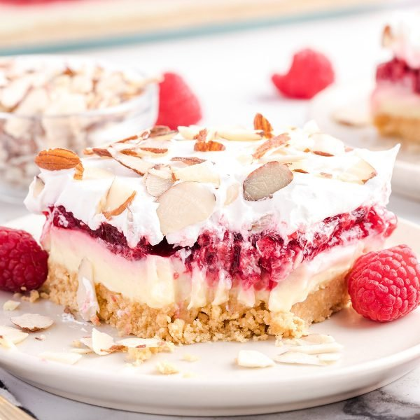 raspberry lasagna on a plate featured image