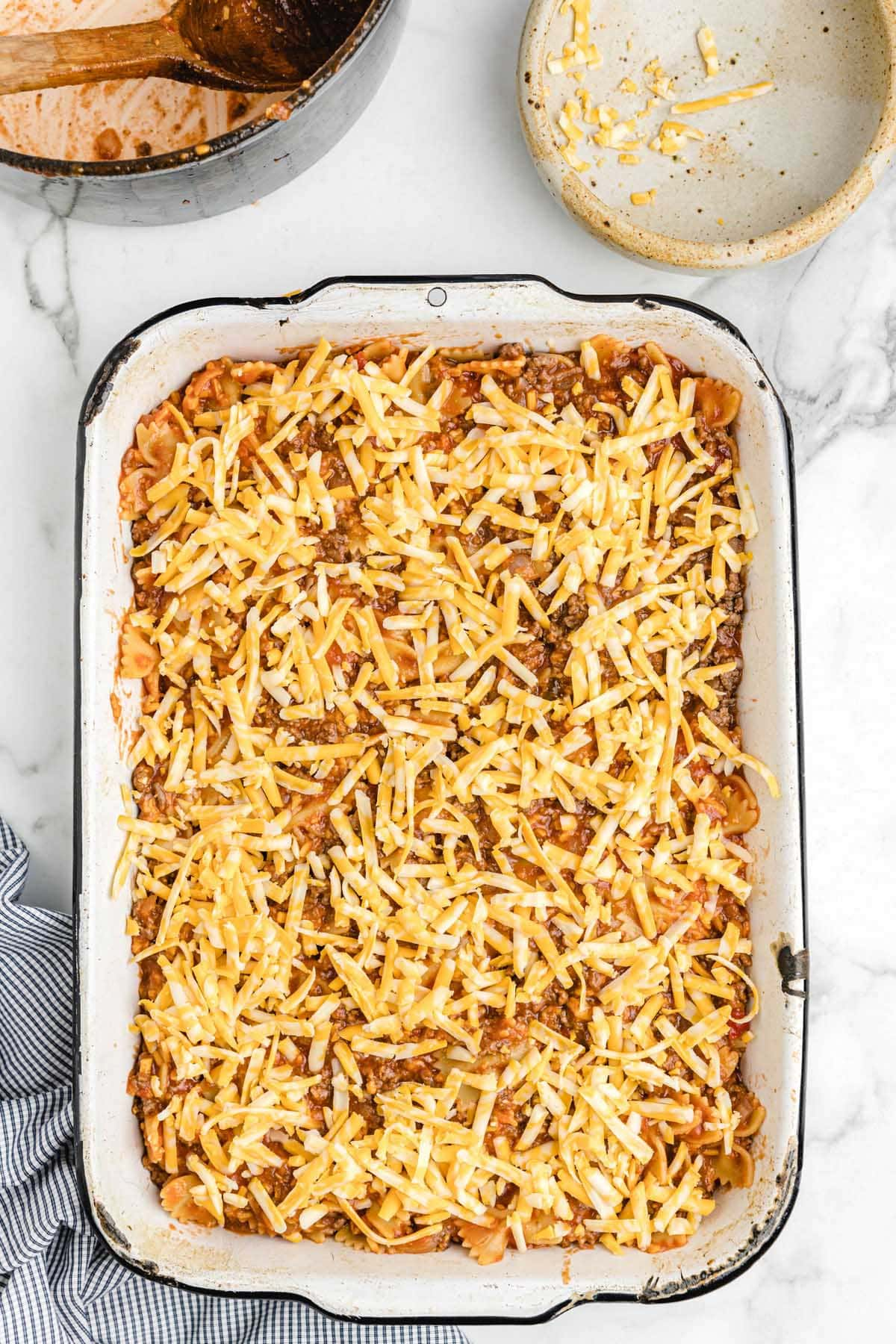 sprinkle cheese into the casserole