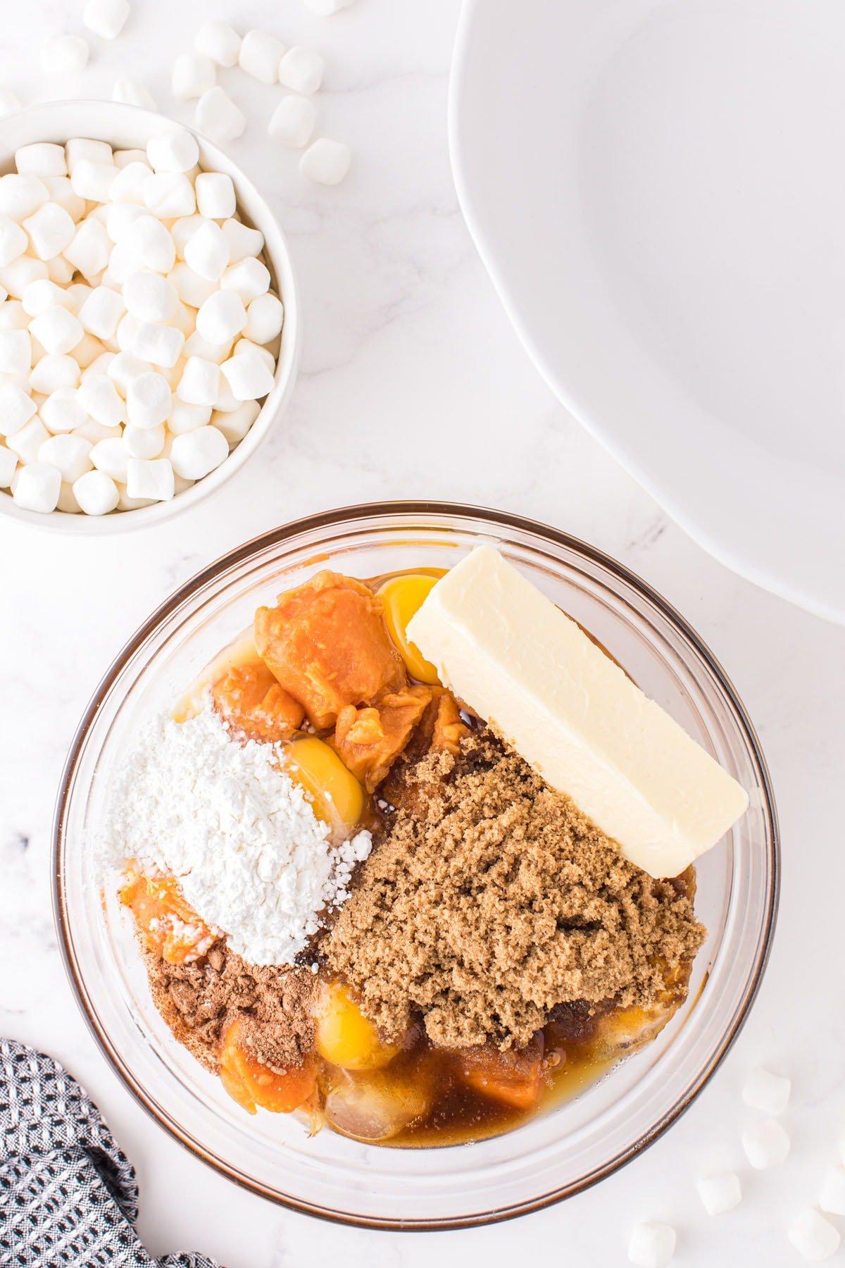 Beat together the sweet potatoes, eggs, dark brown sugar, butter, orange juice, cornstarch, and nutmeg