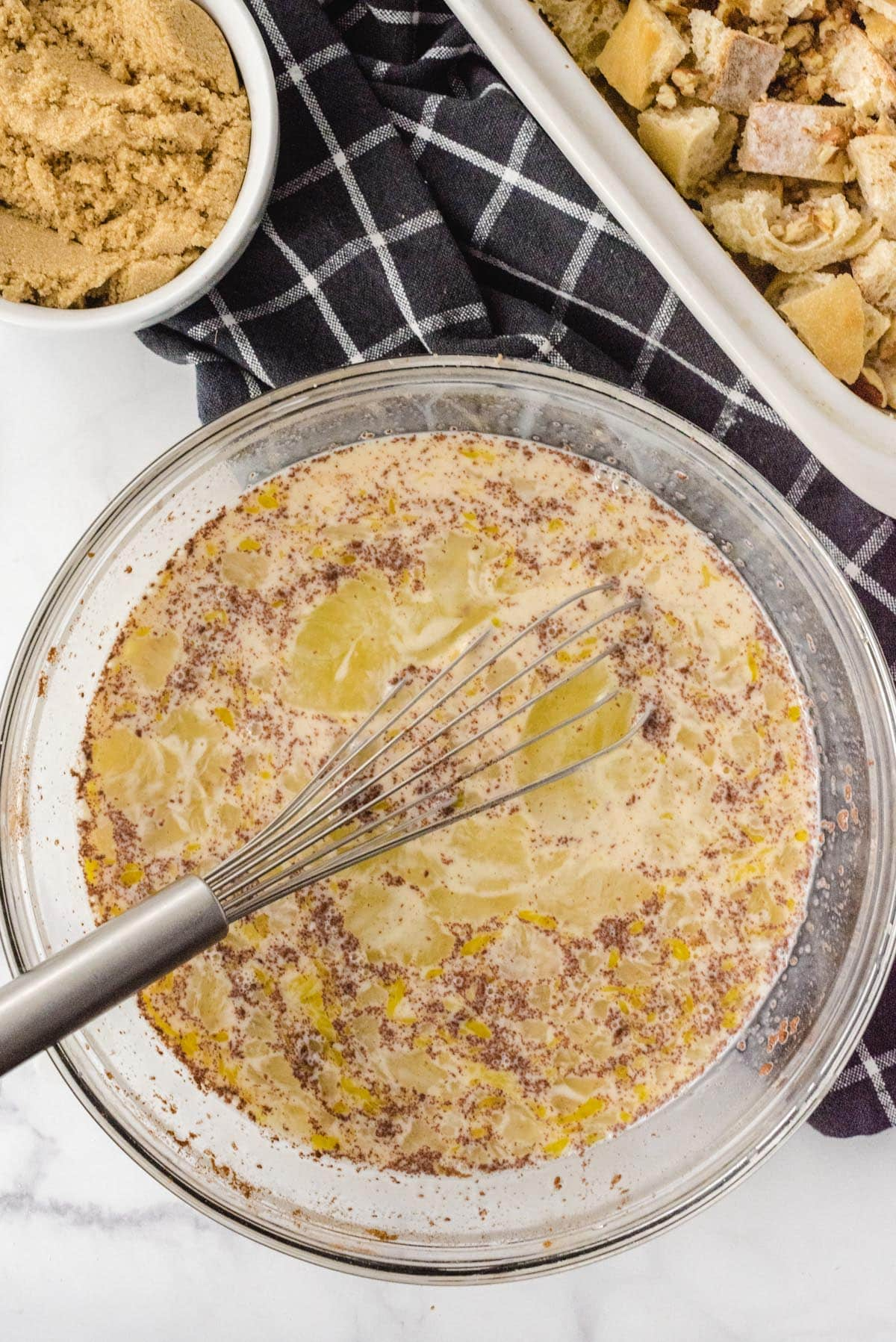 Whisk eggs, whole milk, half and half, sugar, almond extract, cinnamon, salt, and allspice.