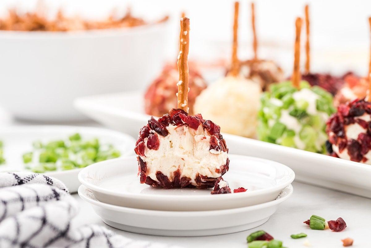 mini cheeseball bitten on top of plate
