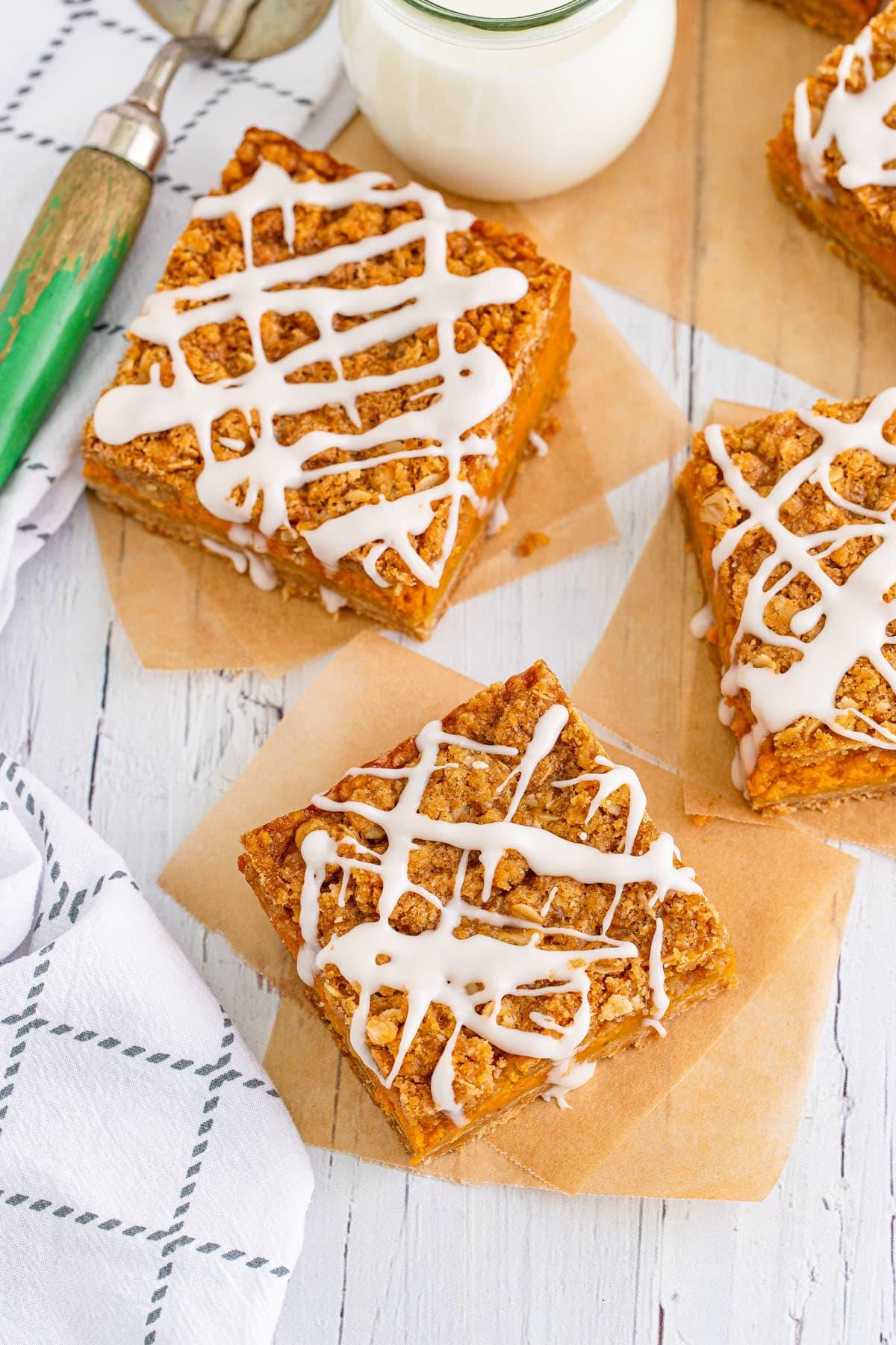 pumpkin streusel bars with glaze on top