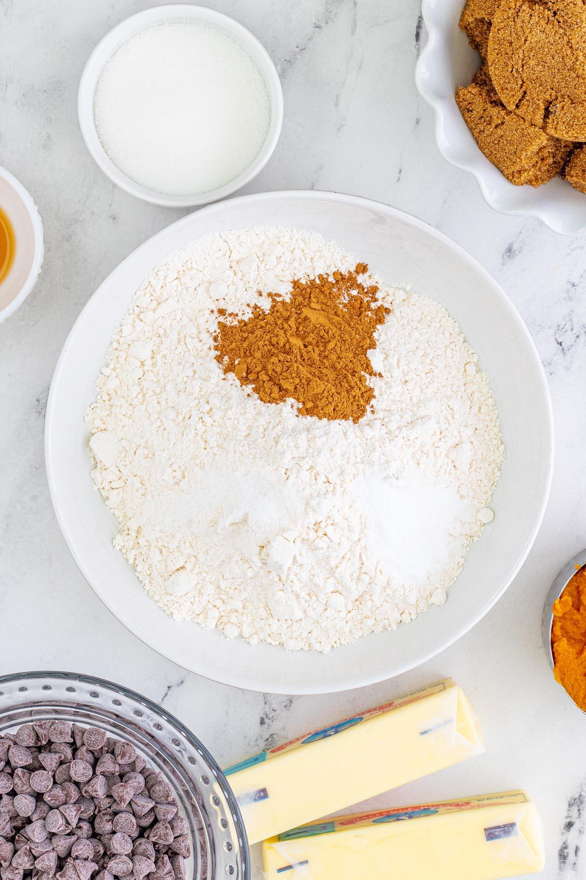 Mix the flour, pumpkin spice, baking soda, and salt together