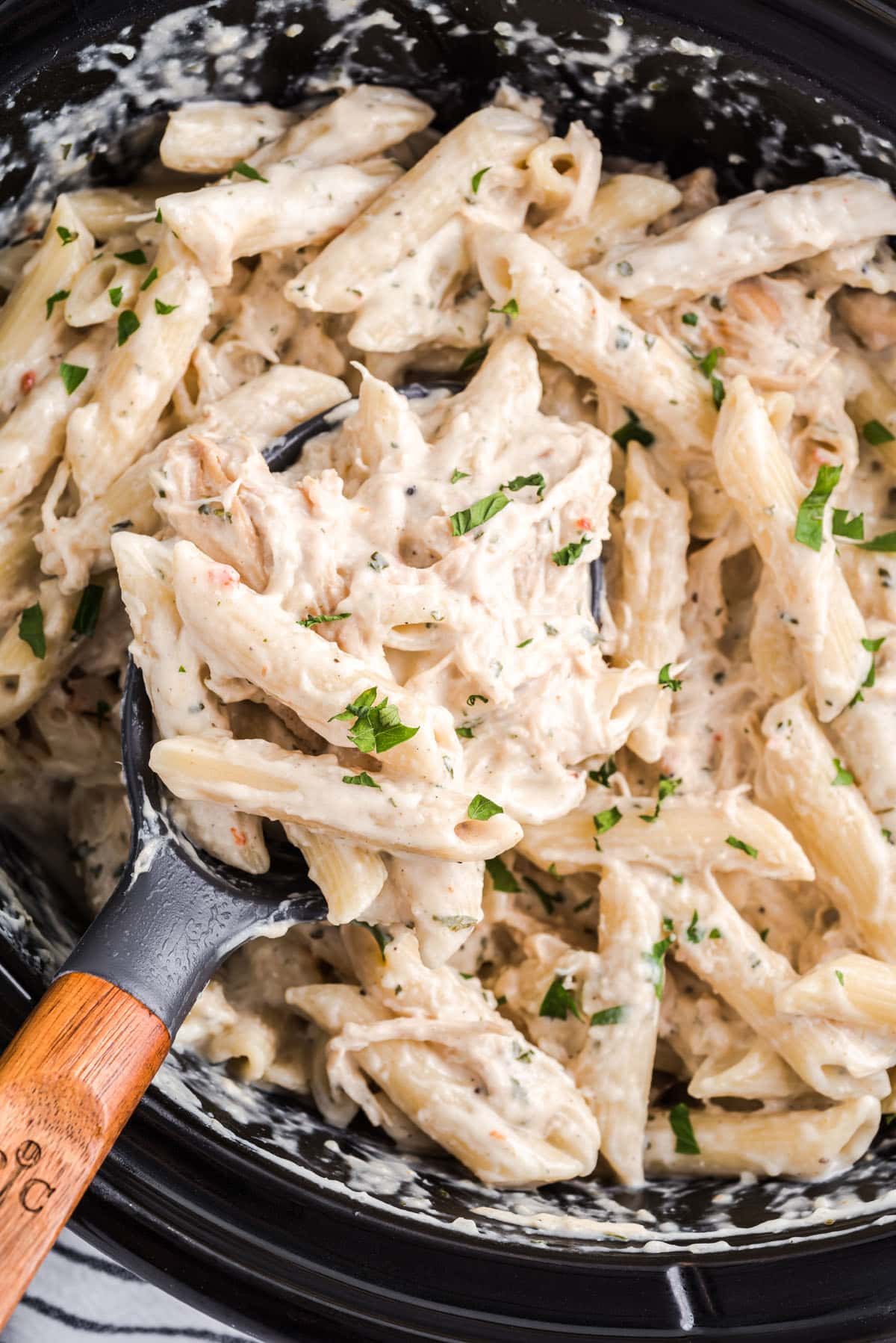 Slow Cooker Olive Garden Chicken Pasta on a spoon