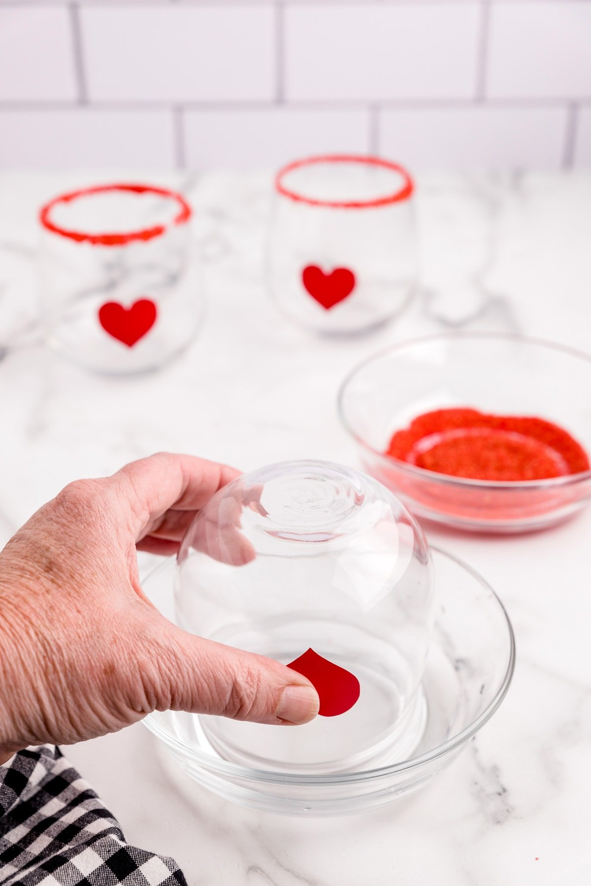 Dip the rim of each glass in water